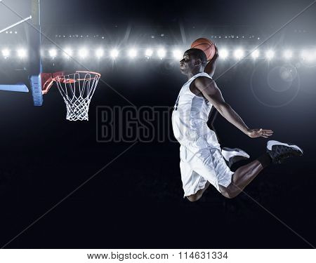 Basketball Player scoring an athletic, amazing slam dunk