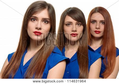 three long-haired women. triplets sisters