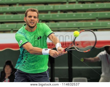 Paul-Henri Mathieu of France stretches for a backhand
