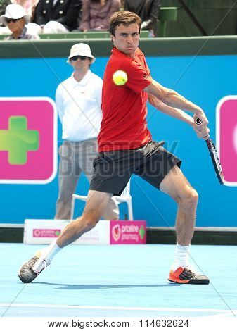 Gilles Simon of France hitting a backhand