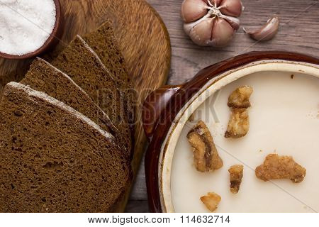 Melted Fat And Brown Bread On Chopping Board
