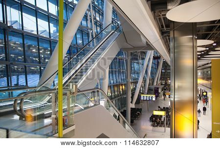 LONDON, UK - MARCH 28, 2015: Interior of Heathrow airport, Terminal 5. Escalators