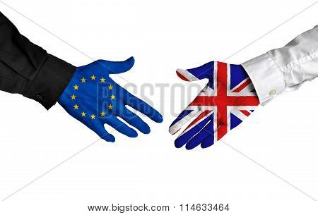 European Union and United Kingdom leaders shaking hands on a deal agreement