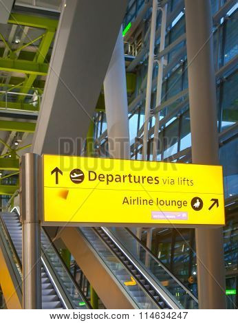 LONDON, UK - MARCH 28, 2015: Departure sign. Interior of departure hall Heathrow airport Terminal 5.