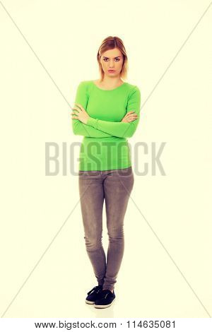 Annoyed woman with arms crossed.