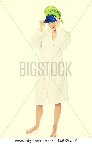 Woman with sleep bandage.