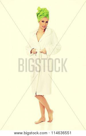 Spa woman in bathrobe and turban.