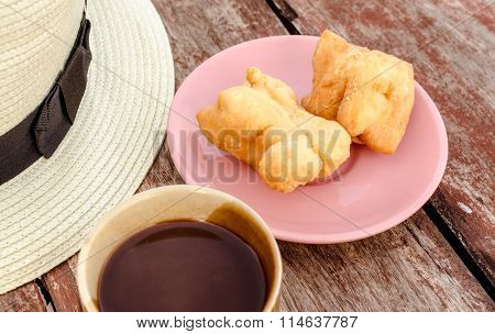 Youtiao (Chinese doughnut) and old style thai local coffee