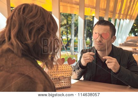 Young Man And Young Girl Look At Each Other Enamored Eyes.