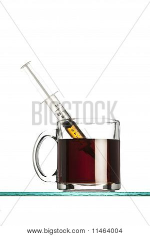 syringe in a cup of coffee