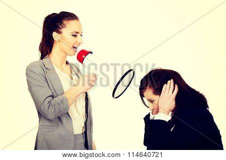 Businesswoman screaming in megaphone.