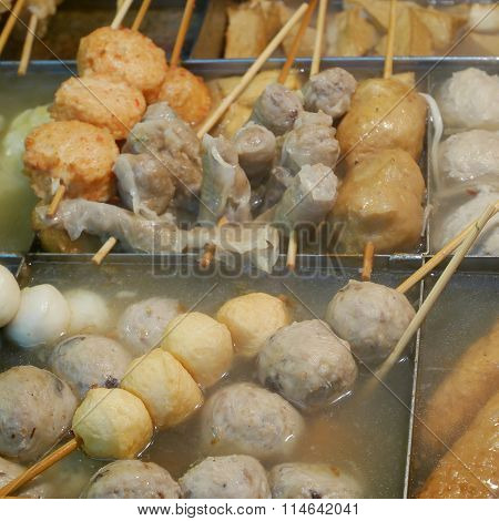 The variety of Japanese delicious oden (fish cake stew) with hot soup in oden pot boiler