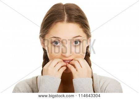 Nervous pensive woman biting nails.