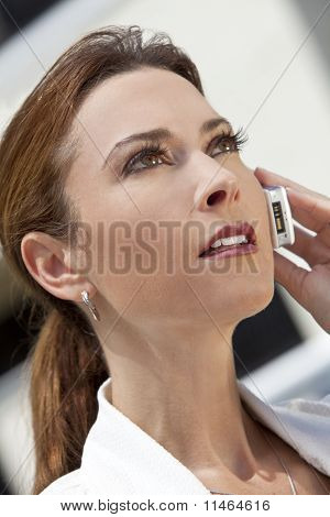 Beautiful Young Woman In Her Thirties Talking On Cell Phone
