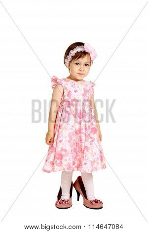 little girl in  dress and big shoes