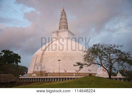 Dagoba in the rays of the setting sun. Sri Lanka