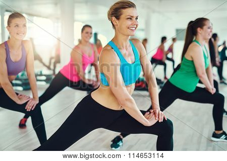 Close-up Of Group Of Fit Young Women Stretching