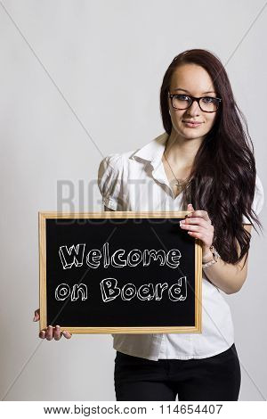Welcome On Board - Young Businesswoman Holding Chalkboard