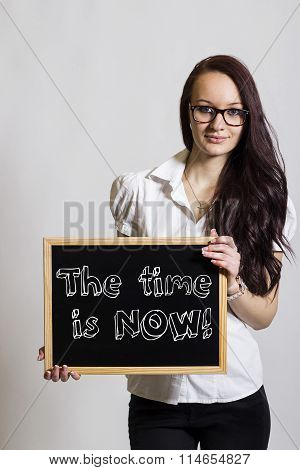 The Time Is Now! - Young Businesswoman Holding Chalkboard