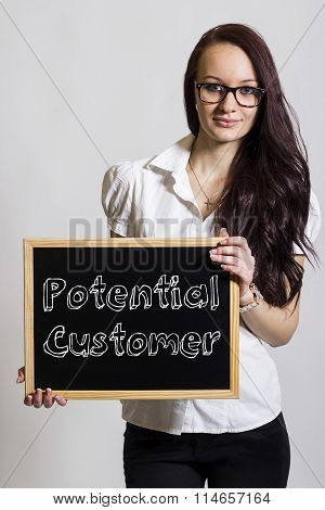 Potential Customer - Young Businesswoman Holding Chalkboard