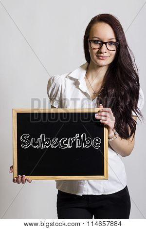 Subscribe - Young Businesswoman Holding Chalkboard