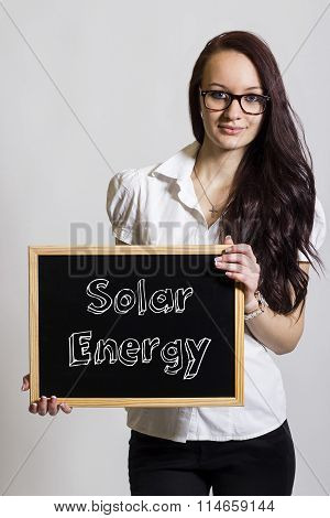 Solar Energy - Young Businesswoman Holding Chalkboard