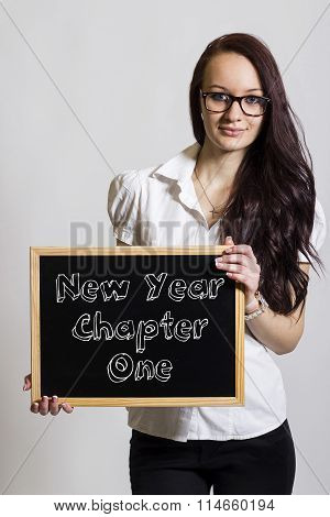 New Year Chapter One - Young Businesswoman Holding Chalkboard