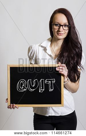 Quit - Young Businesswoman Holding Chalkboard