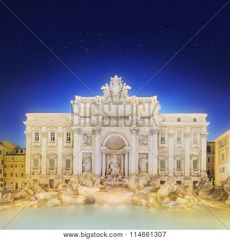 Trevi Fountain illuminated at night Rome, Italy