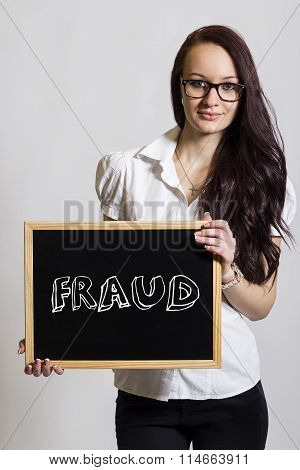 Fraud - Young Businesswoman Holding Chalkboard