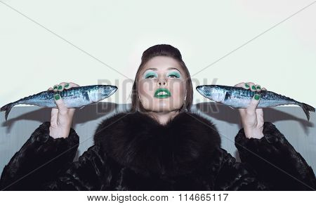 Girl in a fur coat with fish
