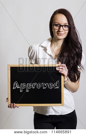 Approved - Young Businesswoman Holding Chalkboard