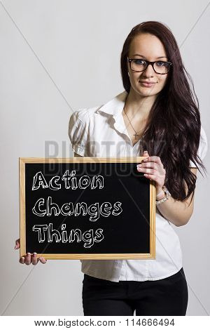 Action Changes Things Act - Young Businesswoman Holding Chalkboard