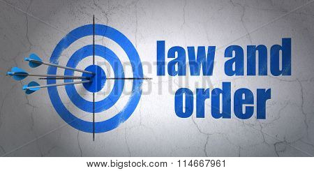 Law concept: target and Law And Order on wall background