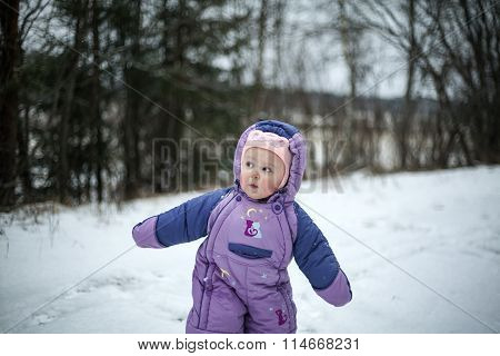 Curious Baby Girl Walking In Cold Winter Day
