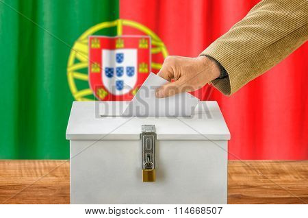 Man Putting A Ballot Into A Voting Box - Portugal