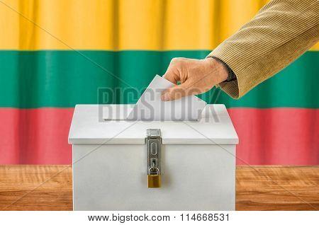 Man Putting A Ballot Into A Voting Box - Lithuania