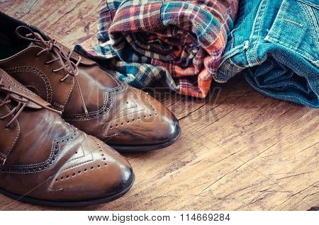 Equipment, Apparel, Jeans, Shirts, Shoes On The Wooden Floor.