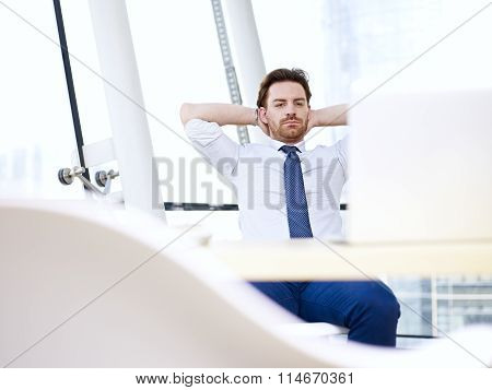 Business Person Looking At Computer Screen Thinking