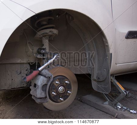 Car wheel on car repair station.