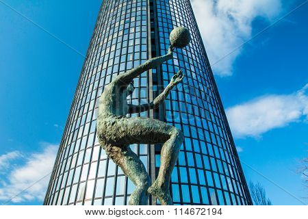 Monument of famous Croatian basketball player Drazen Petrovic and Cibona business tower in backgroun