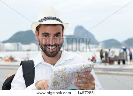 Laughing Tourist With Map At Rio De Janeiro