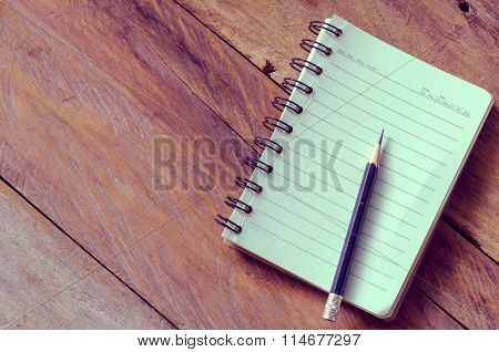 Blank Notebook With Pencil On Wooden Table - Still Life