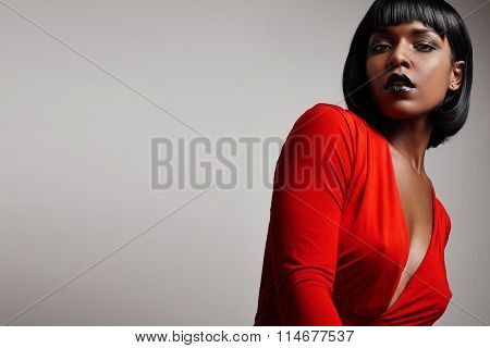 Black Woman With A Straight Short Hair Wearing Red Dress
