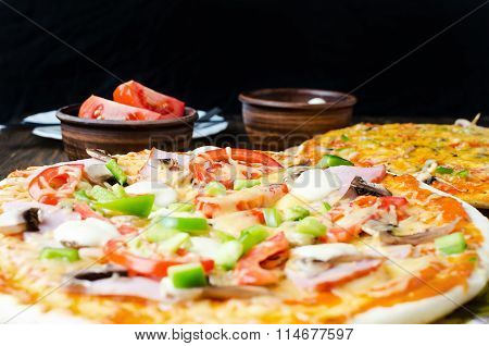 Vegetarian Pizza On A Kitchen Cutting Board, Close Up