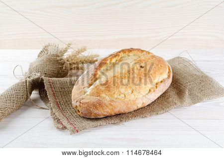 White Fresh Loaf On Sacking