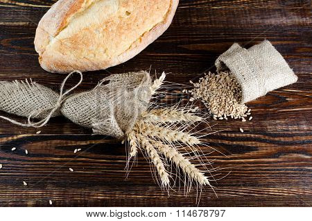 Spikelets Of Wheat Wrapped In Burlap With White Bread