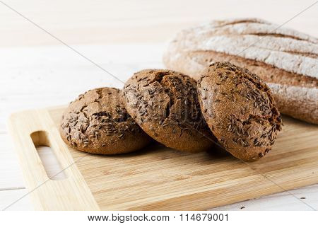 Three Dark Buns With Caraway Seeds