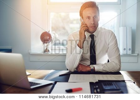 Young White Business Man Talking On The Phone