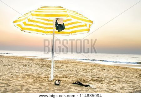 Yellow Umbrella Lonely On The Beach At Sunset In Puglia